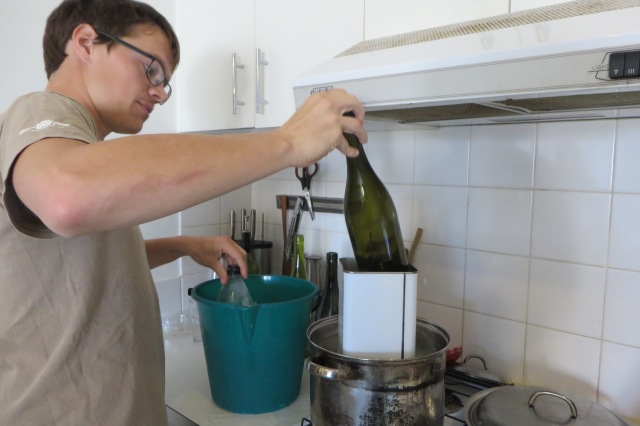 Moving the bottle between boiling hot water (in the saucepan) to icy cold water (in the bucket). The tin in the saucepan was an experiment, but it didn't keep the water hot enough so we removed it later.
