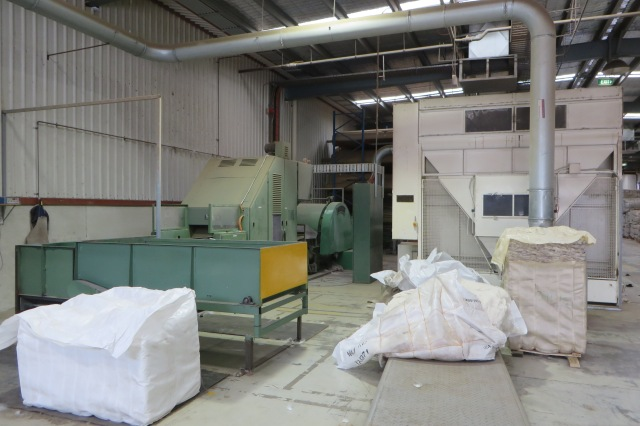 Weighing machine (green, on left) and carder (grey box on right)