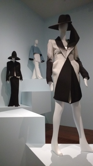 Dion Lee (Sydney) Arc coat dress 2013. At rear: Lui Hon Outfit 2012 and Ellery (Sydney) Protege wide sleeve top, Vienna sleeveless shirt and radical nude boot leg pant 2015