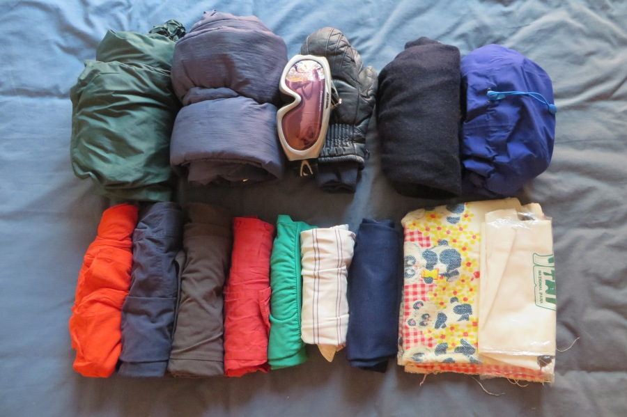 Cross country ski pants, downhill ski pants, ski goggles, ski mittens, rain coat, camping gear: jumper, shorts, pants, 4 x tops, thermals, leech-proof socks. My old baby blanket and an orange pair of pants I use for team activities (we have to wear orange).