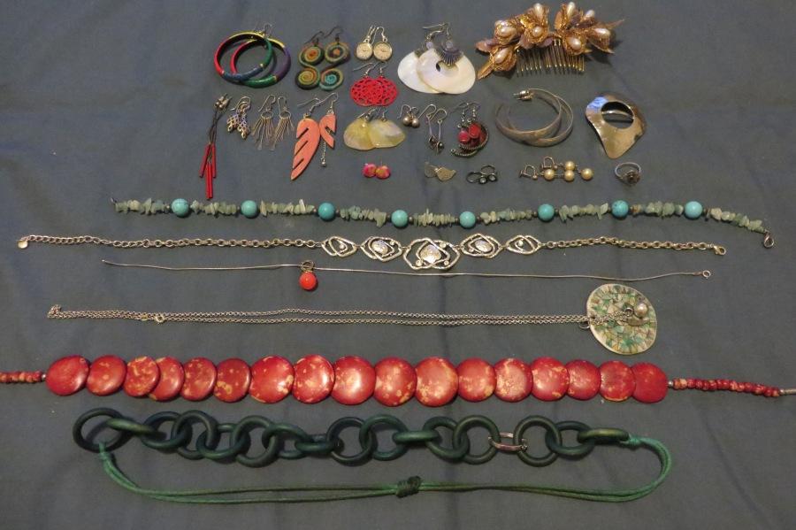 Earrings, hair slide, scarf holder, ring, necklaces.
